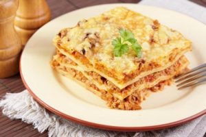 Italian cuisine. Meat lasagna  on the served table